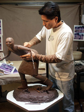 Joe Cajero works on one of his koshare pieces, a jester figure used in the sacred dances.