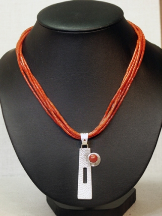 Cuttlebone Cast Sterling with Coral Pendant on a 4-strand Coral Necklace, © Copyright Althea Cajero, CajeroFineArt.com