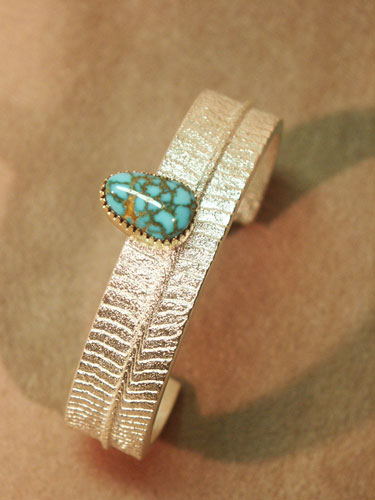 Cuttlebone Cast Sterling with Lone Mountain Turquoise bezel in 18K Gold - Bracelet