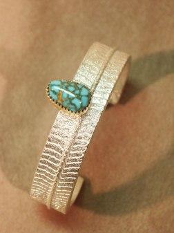 Cuttlebone Cast Sterling with Lone Mountain Turquoise bezel in 18K Gold - Bracelet